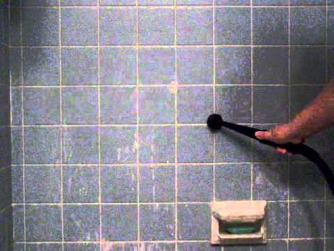 Gruene steam cleaner against bathroom tiles